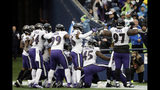 Baltimore Ravens players take part in a group photo touchdown celebration after cornerback Marlon Humphrey recovered a fumble and ran for a touchdown during the second half of an NFL football game against the Seattle Seahawks, Sunday, Oct. 20, 2019, in Seattle. (AP Photo/John Froschauer)