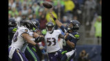 Seattle Seahawks quarterback Russell Wilson (3) passes under pressure from Baltimore Ravens linebacker L.J. Fort, left, during the first half of an NFL football game, Sunday, Oct. 20, 2019, in Seattle. (AP Photo/John Froschauer)
