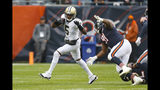 New Orleans Saints quarterback Teddy Bridgewater (5) is chased by Chicago Bears nose tackle Eddie Goldman (91) during the first half of an NFL football game in Chicago, Sunday, Oct. 20, 2019. (AP Photo/Charles Rex Arbogast)