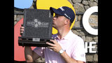 Justin Thomas of the United States kisses his trophy after winning the CJ Cup PGA golf tournament at Nine Bridges on Jeju Island, South Korea, Sunday, Oct. 20, 2019. (Chun Jin-hwan/Newsis via AP)