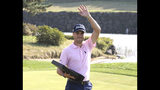Justin Thomas of the United States waves with his trophy after winning the CJ Cup PGA golf tournament at Nine Bridges on Jeju Island, South Korea, Sunday, Oct. 20, 2019. (Chun Jin-hwan/Newsis via AP)
