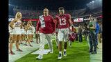 Alabama quarterback Tua Tagovailoa (13) walks off the field hurt against Tennessee during the first half of an NCAA college football game, Saturday, Oct. 19, 2019, in Tuscaloosa, Ala. (AP Photo/Vasha Hunt)