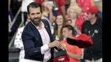 FILE - In this June 18, 2019, file photo, Donald Trump Jr. throws hats to supporters at a campaign rally for President Donald Trump in Orlando, Fla. (AP Photo/John Raoux)
