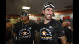 Houston Astros starting pitcher Bryan Abreu, left, and starting pitcher Justin Verlander celebrate in the locker room after winning Game 6 of baseball's American League Championship Series against the New York Yankees Sunday, Oct. 20, 2019, in Houston. The Astros won 6-4 to win the series 4-2. (AP Photo/Matt Slocum)