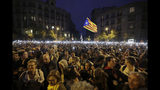 People hold up their phones with the torches switched on during a Catalan pro-independence protest in Barcelona, Spain, Sunday, Oct. 20, 2019. Barcelona and the rest of the restive Spanish region of Catalonia are reeling from several days of violent protests for the sentencing of 12 separatist leaders to lengthy prison sentences.Riots have broken out at nightfall following huge peaceful protests each day since Monday's Supreme Court verdict. (AP Photo/Ben Curtis)