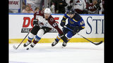 Colorado Avalanche's Gabriel Landeskog (92), of Sweden, controls the puck in front of St. Louis Blues' Ivan Barbashev (49), of Russia, during the first period of an NHL hockey game Monday, Oct. 21, 2019, in St. Louis. (AP Photo/Scott Kane)