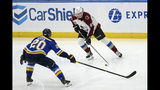Colorado Avalanche's Andre Burakovsky (95), of Austria, handles the puck as St. Louis Blues' Alexander Steen (20) defends during the third period of an NHL hockey game Monday, Oct. 21, 2019, in St. Louis. (AP Photo/Scott Kane)