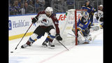St. Louis Blues' goaltender Jordan Binnington (50) watches as Colorado Avalanche's Pierre-Edouard Bellemare (41), of France, handles the puck behind the goal during the first period of an NHL hockey game Monday, Oct. 21, 2019, in St. Louis. (AP Photo/Scott Kane)