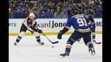 Colorado Avalanche's Nathan MacKinnon (29) handles the puck as St. Louis Blues' Vladimir Tarasenko (91), of Russia, and Jaden Schwartz (17) defend during the second period of an NHL hockey game Monday, Oct. 21, 2019, in St. Louis. (AP Photo/Scott Kane)