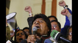 Bolivian President Evo Morales speaks to supporters at the presidential palace in La Paz, Bolivia, after a first round presidential election, Sunday, Oct. 20, 2019. According to official early returns, Morales is in the lead but appears headed to a December runoff against former President Carlos Mesa. (AP Photo/Jorge Saenz)
