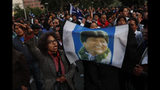 Supporters of Bolivian President Evo Morales, who is running for a fourth term, rally outside the Supreme Electoral Court where election ballots are being counted in La Paz, Bolivia, Monday, Oct. 21, 2019. A sudden halt in release of presidential election returns led to confusion and protests in Bolivia on Monday as opponents suggested officials were trying to help Morales avoid a risky runoff. (AP Photo/Juan Karita)