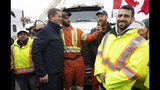 FILE - In this Oct. 17, 2019, file photo, Conservative leader Andrew Scheer poses for a photo with workers during a campaign stop in Brampton, Ontario. Polls show that Scheer has a chance to defeat Justin Trudeau's Liberal party in national elections on Monday, Oct. 21. (Adrian Wyld/The Canadian Press via AP, File)