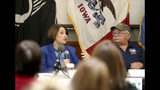 Presidential candidate U.S. Sen. Amy Klobuchar, D-MN., and Jim Wagner, founder and president of the Dubuque Veterans Freedom Center, participate in her roundtable with veterans at Carnegie-Stout Public Library in Dubuque on Saturday, Oct. 19, 2019.(Eileen Meslar/Telegraph Herald via AP)