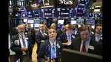FILE - In this Sept. 18, 2019, file photo traders at the New York Stock Exchange follow stock prices just before the Federal Reserve made its interest rate announcement. The U.S. stock market opens at 9:30 a.m. EDT on Monday, Oct. 21. (AP Photo/Mark Lennihan, File)