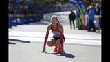 """FILE - In this Nov. 4, 2018 file photo Shalane Flanagan of the United States reacts after crossing the finish line third in the women's division of the New York City Marathon in New York. Flanagan says she is retiring from competitive running to become a coach. She made the announcement Monday, Oct. 21, 2019 saying she has only one regret: """"I regret I can't do it all over again."""" (AP Photo/Seth Wenig, file)"""