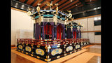This Saturday, Oct. 19, 2019, photo shows Takamikura throne with Michodai, right, a curtained platform, placed at Imperial Palace in Tokyo. The Takamikura throne will be used at a ceremony for Emperor Naruhito's proclamation on Oct. 22, 2019. (Kyodo News via AP)
