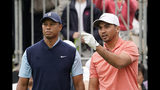 Jason Day of Australia, right, talks with Tiger Woods of the United States, left, on the first hole during the Challenge: Japan Skins event ahead of the Zozo Championship PGA Tour at Accordia Golf Narashino C.C. in Inzai, east of Tokyo, Monday, Oct. 21, 2019. (AP Photo/Lee Jin-man)