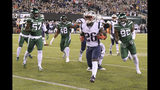New England Patriots running back Sony Michel (26) gets away from New York Jets' C.J. Mosley (57) and Leonard Williams (92) for a touchdown during the first half of an NFL football game Monday, Oct. 21, 2019, in East Rutherford, N.J. (AP Photo/Bill Kostroun)