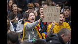 Catalan pro-independence protesters demonstrate outside the building of the Government Delegation in the Autonomous Community of Catalonia, in downtown Barcelona, Spain Monday, Oct. 21, 2019. Spanish leader Pedro Sanchez is traveling to Barcelona Monday, the protest-struck capital of the northeastern Catalonia region, to visit with injured police officers and talks with officials in charge of security. (AP Photo/Ben Curtis)