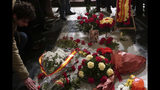In this photo taken on Tuesday, Nov. 20, 2018, flowers are placed on the tomb of former Spanish dictator Francisco Franco inside the basilica at the the Valley of the Fallen monument near El Escorial, outside Madrid. After a tortuous judicial and public relations battle, Spain's Socialist government has announced that Gen. Francisco Franco's embalmed body will be relocated from a controversial shrine to a small public cemetery where the former dictator's remains will lie along his deceased wife. (AP Photo/Manu Fernandez)