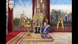 In this undated photo posted Monday, Aug. 26, 2019, on the Thailand Royal Office website, Thailand's King Maha Vajiralongkorn sits on the thrown with his official consort Sineenatra Wongvajirabhakdi at the royal palace. Late Monday, Oct. 21, 2019, it was announced that Sineenatra has been stripped of her titles and military ranks for disloyalty, accusing her of seeking to undermine the position of his official wife for her own benefit. (Thailand Royal Office via AP)