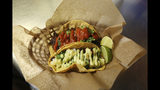 In this Thursday, Oct. 10, 2019 photo, fresh tacos served up at the Mi Vegana Madre restaurant offering Mexican vegan food in Glendale, Ariz. No longer just a few items on a mainstream restaurant's menu, vegan Mexican food has become a widening industry on its own with Latinos taking control of the kitchen. (AP Photo/Ross D. Franklin)