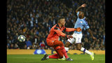 Manchester City's Raheem Sterling, right, scores his side's fifth goal, during the group C Champions League soccer match between Manchester City and Atalanta at the Etihad Stadium in Manchester, England, Tuesday, Oct. 22, 2019. On the left is Atalanta's goalkeeper Pierluigi Gollini. (AP Photo/Dave Thompson)