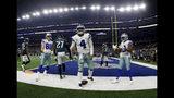 Dallas Cowboys quarterback Dak Prescott (4), Blake Jarwin (89), Randall Cobb (18) celebrate a touchdown scored by Prescott on a running play as Philadelphia Eagles' Malcolm Jenkins (27) walks away in the second half of an NFL football game in Arlington, Texas, Sunday, Oct. 20, 2019. (AP Photo/Ron Jenkins)