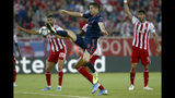 Bayern's Robert Lewandowski scores his second goal during the Champions League group B soccer match between Olympiakos and Bayern Munich at the Georgios Karaiskakis stadium in Piraeus port, near Athens, Tuesday, Oct. 22, 2019. (AP Photo/Petros Giannakouris)