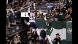 New England Patriots' Terrence Brooks (25) intercepts a pass to New York Jets' Demaryius Thomas (18) during the second half of an NFL football game, Monday, Oct. 21, 2019, in East Rutherford, N.J. (AP Photo/Adam Hunger)