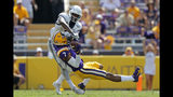 FILE - In this Oct. 5, 2019, file photo, LSU safety Grant Delpit (7) pulls in an interception against Utah State wide receiver Savon Scarver in the second half of an NCAA college football game in Baton Rouge, La. Delpit was selected to the AP Midseason All-America NCAA college football team, Tuesday, Oct. 15, 2019. (AP Photo/Gerald Herbert, File)