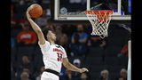 FILE - In this March 13, 2019, file photo, Louisville's Jordan Nwora (33) dunks against Notre Dame during the second half of an NCAA college basketball game in the Atlantic Coast Conference tournament in Charlotte, N.C. Michigan State senior guard Cassius Winston, Marquette guard Markus Howard, Louisville junior forward Jordan Nwora, Seton Hall senior guard Myles Powell and Memphis freshman James Wiseman headline The Associated Press 2019-20 preseason All-America team announced Tuesday, Oct. 22, 2019. (AP Photo/Nell Redmond, File)