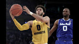 FILE - In this March 15, 2019, file photo, Marquette guard Markus Howard (0) goes up for a shot against Seton Hall guard Quincy McKnight (0) during the first half of an NCAA college basketball semifinal game in the Big East men's tournament,, in New York. Michigan State senior guard Cassius Winston, Marquette guard Markus Howard, Louisville junior forward Jordan Nwora, Seton Hall senior guard Myles Powell and Memphis freshman James Wiseman headline The Associated Press 2019-20 preseason All-America team announced Tuesday, Oct. 22, 2019. (AP Photo/Julio Cortez, FIle)