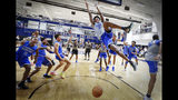 In this Sept. 24, 2019, photo, Memphis center James Wiseman dunks as his teammates celebrate during an open practice for the NCAA college basketball team in front of the Rebounders Club in Memphis, Tenn. Wiseman was selected as a member of The Associated Press preseason All-America team Tuesday, Oct. 22. (Mark Weber/Daily Memphian via AP)