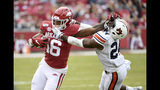 Arkansas receiver Treylon Burks stiff arms Auburn defender Daniel Thomas as he tries to run the ball during the second half of an NCAA college football game, Saturday, Oct. 19, 2019 in Fayetteville, Ark. (AP Photo/Michael Woods)