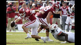 Arkansas quarterback Ben Hicks tries to get away from Auburn defender Derrick Brown as he scrambles out of the pocket during the second half of an NCAA college football game, Saturday, Oct. 19, 2019 in Fayetteville, Ark. (AP Photo/Michael Woods)