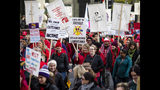 Thousands of Chicago Teachers Union members and their supporters march through the Loop on day two of a Chicago Public Schools district-wide strike, Friday, Oct. 18, 2019. (Ashlee Rezin Garcia/Chicago Sun-Times via AP)