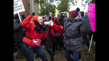 Striking Chicago Teachers Union and SEIU Local 73 members rally on the picket line outside Oscar DePriest Elementary School in Chicago, Tuesday, Oct. 22, 2019. (Ashlee Rezin Garcia/Chicago Sun-Times via AP)