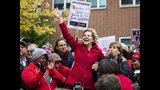 Presidential candidate Sen. Elizabeth Warren, D-Mass., joins educators picketing outside Oscar DePriest Elementary School in Chicago, Tuesday, Oct. 22, 2019. Warren called for people across the country to support striking Chicago teachers. (Ashlee Rezin Garcia/Chicago Sun-Times via AP)