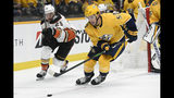 Anaheim Ducks center Devin Shore (29) and Nashville Predators defenseman Dante Fabbro (57) chase the puck during the first period of an NHL hockey game Tuesday, Oct. 22, 2019, in Nashville, Tenn. (AP Photo/Mark Zaleski)