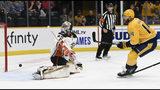 Nashville Predators defenseman Mattias Ekholm (14), of Sweden, scores a goal against Anaheim Ducks goaltender John Gibson (36) during the second period of an NHL hockey game Tuesday, Oct. 22, 2019, in Nashville, Tenn. (AP Photo/Mark Zaleski)