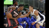 Miami Heat's Jimmy Butler (22) looks to get past Orlando Magic's Aaron Gordon, right, during the second half of an NBA preseason basketball game, Thursday, Oct. 17, 2019, in Orlando, Fla. (AP Photo/John Raoux)