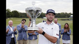 Lanto Griffin hoists the Championship trophy during presentation ceremonies after winning the Houston Open golf tournament Sunday, Oct, 13, 2019, in Houston. (AP Photo/Michael Wyke)