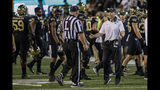 Wake Forest coach Dave Clawson argues with official Kirk Lewis after losing an onside-kick attempt during the second half of the team's NCAA college football game against Louisville in Winston-Salem, N.C., Saturday, Oct. 12, 2019. Louisville won 62-59. (AP Photo/Nell Redmond)