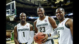 Michigan State's Joshua Langford, Xavier Tillman and Cassius Winston, from left, pose for a photo during the NCAA college basketball team's media day Tuesday, Oct. 15, 2019, in East Lansing, Mich. (Nick King/Lansing State Journal via AP)
