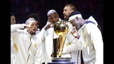 Toronto Raptors' Norman Powell, Serge Ibaka, Marc Gasol and Pascal Siakam , from left, stand with their rings behind the Larry O'Brien NBA Championship Trophy before playing the New Orleans Pelicans in Toronto on Tuesday Oct. 22, 2019. The Raptors defeated the Golden State Warriors to win the NBA title for the first time in franchise history. (Frank Gunn/The Canadian Press via AP)