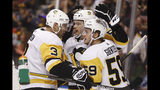 Pittsburgh Penguins' Teddy Blueger, center, celebrates with teammates Jake Guentzel (59) and Jack Johnson (3) after Blueger scored during the second period of the team's NHL hockey game against the Florida Panthers, Tuesday, Oct. 22, 2019, in Sunrise, Fla. (AP Photo/Brynn Anderson)