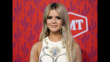 """FILE - This June 5, 2019 file photo shows Maren Morris at the CMT Music Awards in Nashville, Tenn. The Grammy-winning country singer posted of a photo of herself with her husband Ryan Hurd on Instagram on Tuesday announcing her pregnancy, saying """"the universe would give us a baby boy to even things out."""" (AP Photo/Sanford Myers, File)"""