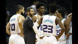 Charlotte Hornets coach James Borrego huddles with his team during a break in play against the Detroit Pistons during the second half of an NBA preseason basketball game in Charlotte, N.C., Wednesday, Oct. 16, 2019. The Pistons won 116-110. (AP Photo/Bob Leverone)