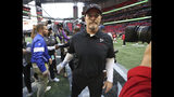 Atlanta Falcons head coach Dan Quinn, center, leaves the field after shaking hands with Los Angeles Rams head coach Sean McVay after an NFL football game Sunday, Oct. 20, 2019, in Atlanta. (Curtis Compton/Atlanta Journal-Constitution via AP)